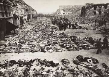 German civilians remove the bodies of prisoners killed in the Nordhausen concentration camp and lay them out in long rows outside the central barracks (Boelke Kaserne). Nordhausen, Germany, April 12, 1945. <i>US Holocaust Memorial Museum, courtesy of National Archives and Records Administration, College Park, MD</i>