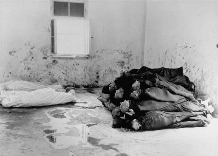 Corpses are piled in the crematorium mortuary in the newly liberated Dachau concentration camp. Dachau, Germany, May 1945. <i>US Holocaust Memorial Museum, courtesy of Merle Spiegel</i>