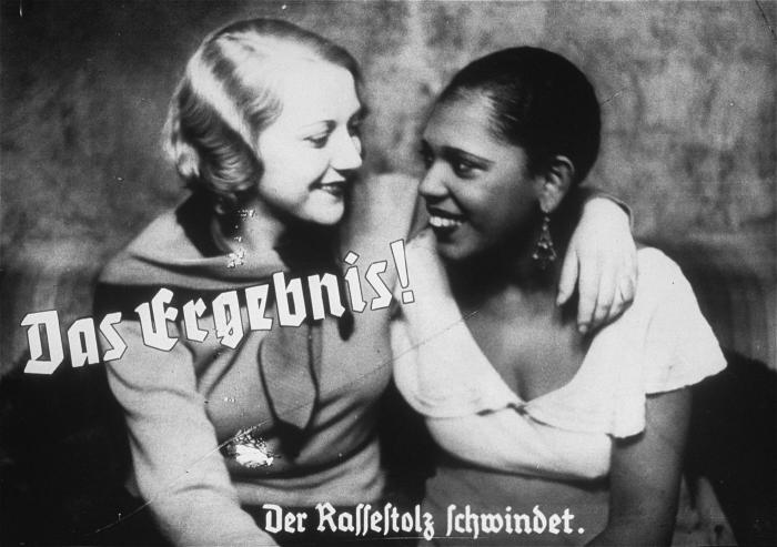"African-Germans: Propaganda photo from Hitler Youth film strip. Caption says: ""The result! The loss of racial pride."" US Holocaust Memorial Museum"