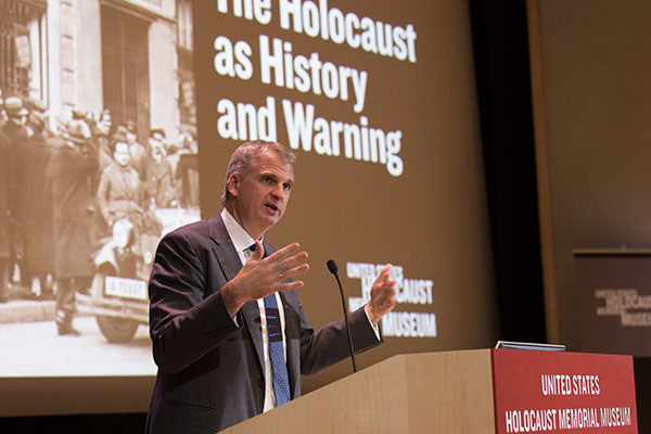 "A presenter talks at an event at the Museum, ""The Holocaust as History and Warning"""