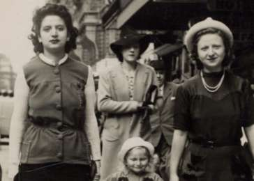 Fajga Aizenberg (right), her sister, Rose Orenbuch, and daughter, Josiane, walk down the street hand in hand, circa 1941.