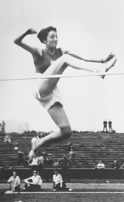 Gretel Bergmann (now Margaret Lambert) competes in the high jump during a competition in Stuttgart.