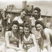 Group portrait of six young Jewish women sunbathing in the Warsaw ghetto on the day they finished their high school matriculation exams in July 1942. This image demonstrates the will to continue with life even under extreme circumstances.USHMM #23282, courtesy of Eugenia Tabaczynska Shrut