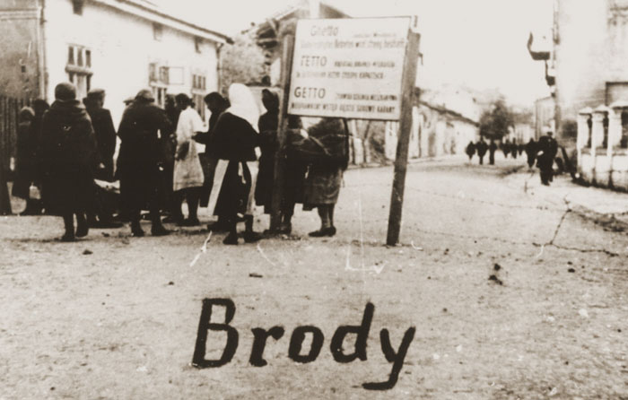 A group of Jewish women at the entrance to the Brody ghetto, Ukraine.