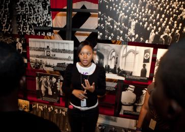 Student leaders give tours of the Permanent Exhibition. <i>US Holocaust Memorial Museum</i>