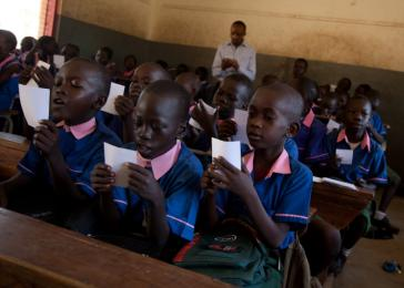 A Catholic primary school with 1,000 students, Usratuna Basic Education School is known as one of the best primary schools in Juba, South Sudan. Despite its strong reputation, the school faces many constraints, such as overcrowded classes (between 50 and 85 students per class) and a dearth of resources: the school has no library and few textbooks. <i>US Holocaust Memorial Museum, gift of Lucian Perkins</i>