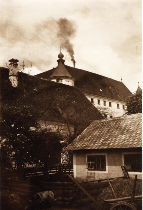 A clandestine photograph taken by a farmer who lived in the vicinity of Hartheim, showing smoke rising from the chimney of the crematorium. Operation T-4 targeted mostly adult patients in private, state, and church-run institutions. <i>Wolfgang Schuhmann</i>