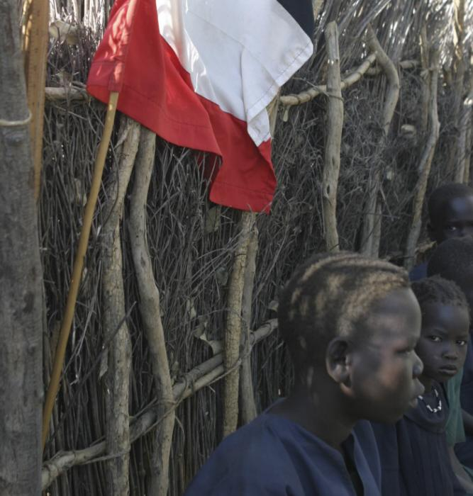Sudan People&#8217;s Liberation Movement/Army Flag. Northern Bahr al-Ghazal, Southern Sudan. December 2004. <i>James Nicholls for US Holocaust Memorial Museum.</i>