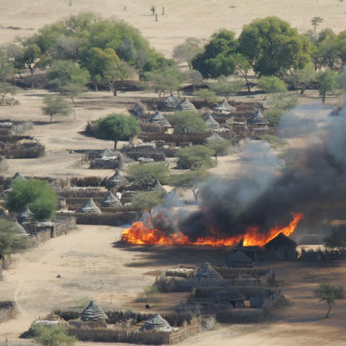 The burning of Um Ziefa in Darfur, Sudan. December 12, 2004.
