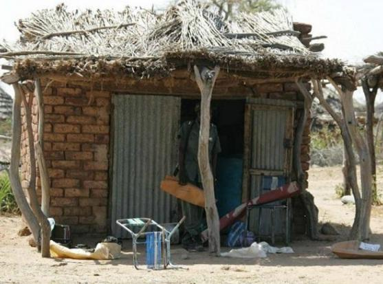 A government soldier who looted a store after the attack on Amaka Sara in Darfur, Sudan.