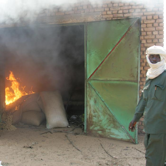A government soldier who began burning the food storage of the villagers in Marla. December 17, 2004.