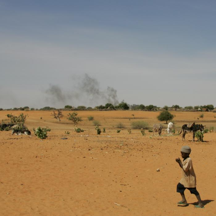 Outside the burning village of Marla in Darfur, Sudan. December 17, 2004.