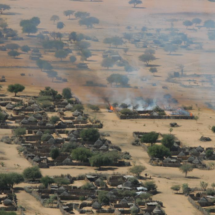 The burning of the village of Labado in Darfur, Sudan. December 19, 2004.