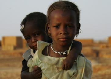 A girl and her brother in Kounoungo Camp in Chad. <i>Brian Steidle for US Holocaust Memorial Museum</i>