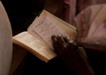 The Catholic Church launched a country-wide &#8220;101 Days of Prayer for Peace&#8221; to last until the scheduled January referendum on independence for South Sudan. Here, a parishioner prays at the Holy Family Parish Church in Rumbek, South Sudan. <i>US Holocaust Memorial Museum, gift of Lucian Perkins</i>
