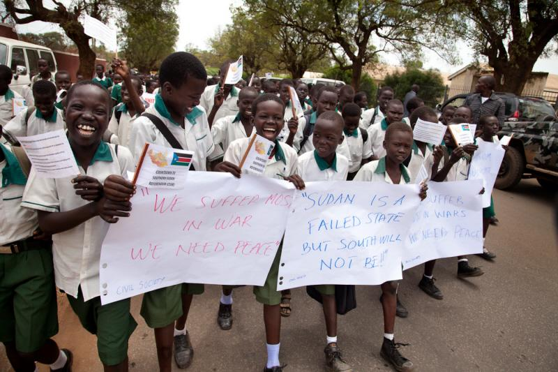 Schoolchildren wait in anticipation for the arrival of the US Ambassador to the United Nations and members of the UN Security Council, who have traveled to South Sudan to underscore their support for the January referendum on the region's independence. <i>US Holocaust Memorial Museum, gift of Lucian Perkins</i>