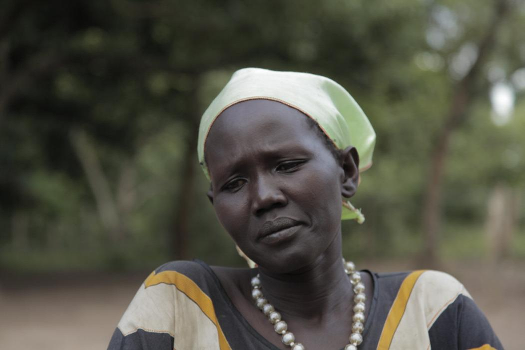 At the Women for Women International center in Rumbek, South Sudan, 37-year-old Helena shares stories from her life during the North-South civil war. <i>US Holocaust Memorial Museum, gift of Lucian Perkins</i>