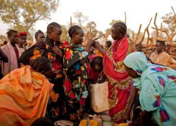 Nuba refugees argue over access to water at an overcrowded pump in the Yida refugee camp. <i>Pete Muller for US Holocaust Memorial Museum</i>
