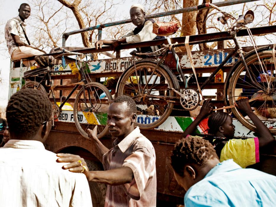 Refugees from the Nuba Mountains on the move outside Yida, South Sudan. <i>Pete Muller for US Holocaust Memorial Museum</i>
