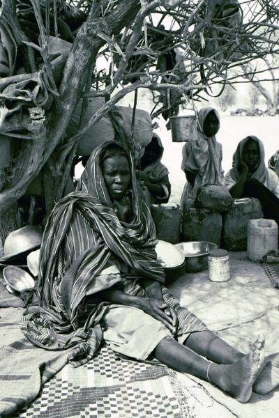 Bahai, Chad. Hadiya Adam Ahmed, who recently crossed into Chad, lives under a tree. She was shot twice by a Sudanese soldier guarding a well. May 2004. <i>US Holocaust Memorial Museum</i>