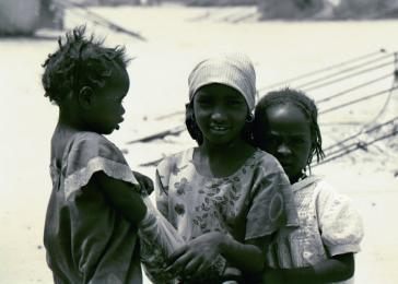 Touloum refugee camp. Like kids anywhere, many of the refugee children in Chad are living in the moment, even though they have seen things no child should have to seen, borne burdens no child should have to bear. What future will these children have? May 2004. <i>US Holocaust Memorial Museum</i>