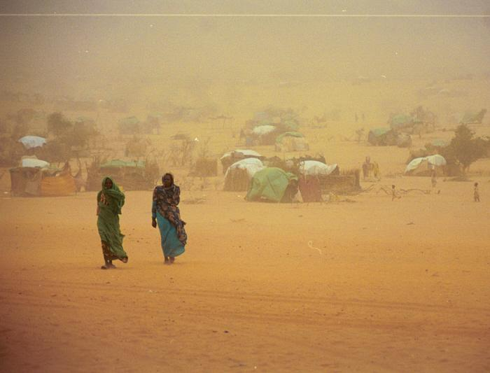 Touloum refugee camp, Chad. In addition to high temperatures in excess of 110 degrees, the refugees also must cope with sandstorms. Soon, seasonal rains will add to their misery, making access to the camps more difficult and increasing the risk of diseases, such as malaria and cholera. May 2004. <i>US Holocaust Memorial Museum</i>
