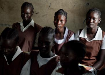Young girls wait for their teacher to show up to class in Malakal, the capital of Upper Nile state in South Sudan. Many times teacher do not show up because they are paid very little. The students sit and study in class anyway. <i>US Holocaust Memorial Museum, gift of Lucian Perkins</i>