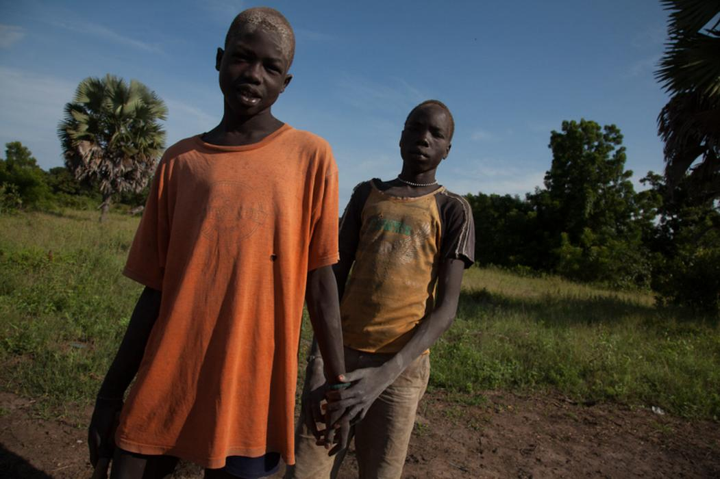 Portrait of two Dinka children who are tending to their families&#8217; cows in Rumbek, South Sudan. For many tribes, cows are the main source of food and wealth. <i>US Holocaust Memorial Museum, gift of Lucian Perkins</i>