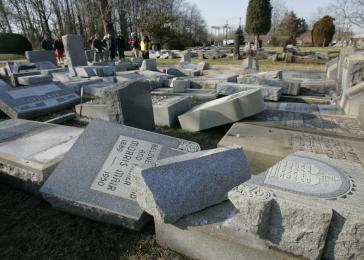 Hundreds of headstones were overturned at a cemetery used by two synagogues. New Brunswick, NJ, January 2008.