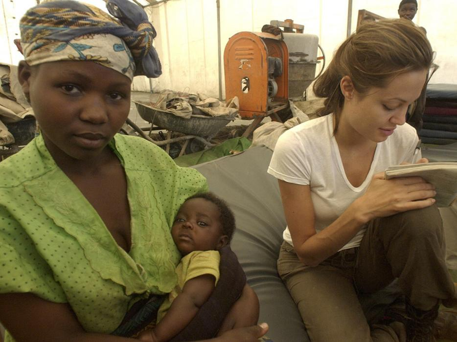 Angelina Jolie listens as a married woman tells her story.