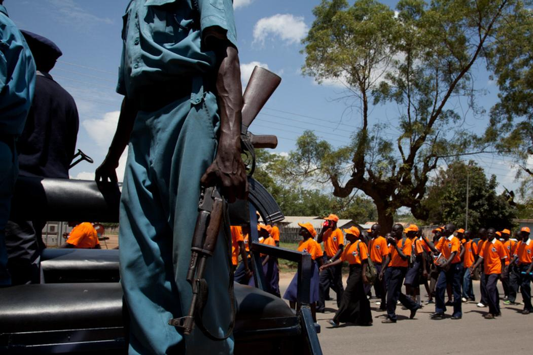 On the 9th of each month rallies are held throughout South Sudan to show support for the January 9th referendum for independence. Here, soldiers keep an eye out during the rally. <i>US Holocaust Memorial Museum, gift of Lucian Perkins</i>