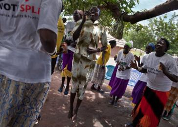 Women sing and dance at an International Rescue Committee support group against gender violence. Rumbek, South Sudan. <i>US Holocaust Memorial Museum, gift of Lucian Perkins</i>