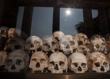 Inside the Killing Fields Memorial are some of the skulls of victims killed at Choeung Ek by the Khmer Rouge. October 2012.