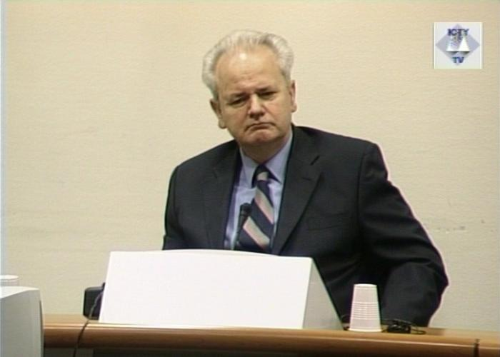 Former Yugoslav President Slobodan Milosevic stands trial for war crimes at the International Criminal Tribunal, The Hague, 2001.