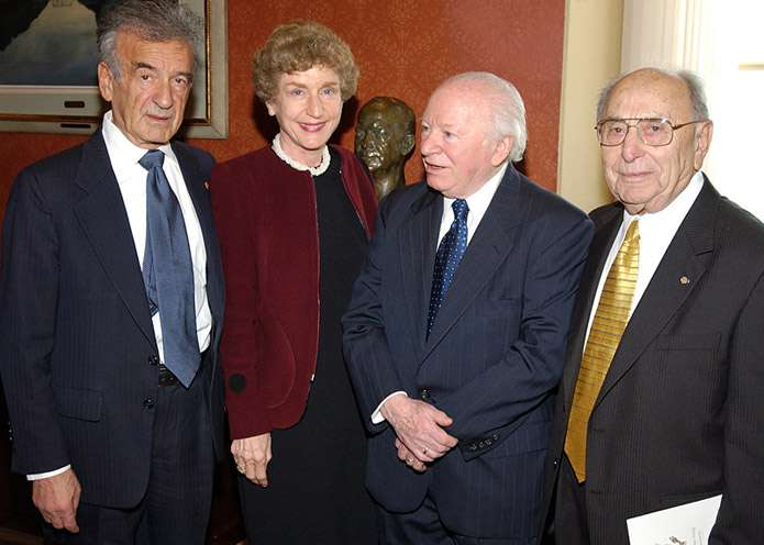 Miles Lerman (far right) gathers with Elie Wiesel (far left), Ruth Mandel, and Benjamin Meed for the 2003 Days of Remembrance ceremony. <i>US Holocaust Memorial Museum</i>