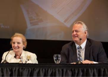 Madeleine K. Albright and Richard S. Williamson, co-chairs of the Working Group on the Responsibility to Protect, speak at a July 2013 symposium.