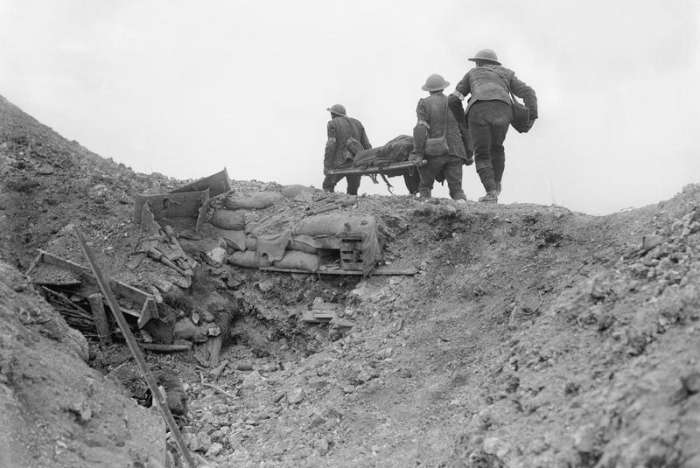 Stretcher bearers carry a wounded soldier during the Battle of the Somme. France, September 1916.