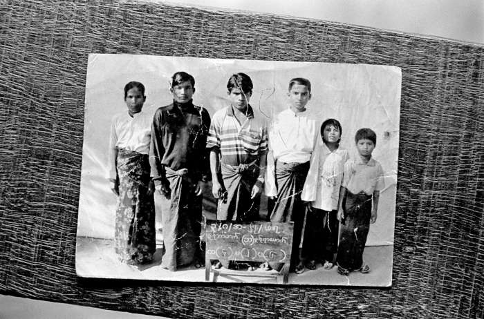 In Burma, authorities closely monitor Rohingya families. Most are not permitted to travel beyond their own village, and the authorities regularly update household registers so they know who and how many Rohingya are in each house. Any discrepancies are punishable by fines and arrest. Authorities took this photograph of a Rohingya family living in Rakhine State in western Burma.
