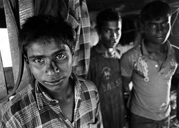 Each year thousands of desperate Rohingya flee Burma in flimsy boats to countries throughout the region, where most are forced back out to sea, confined to detention centers, or sold to human traffickers. These young men are preparing a boat to take some 200 Rohingya men, women, and children from Sittwe to Malaysia. While at sea, the boat was apprehended by Burmese authorities and, after being detained for a month, forced back to Sittwe.