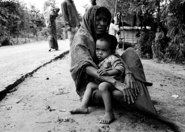 Denied citizenship and rendered stateless by successive Burmese governments, the 800,000 Rohingya are among the world's most persecuted peoples. Some 200,000, including this woman and her grandchild, have fled human rights abuses in Burma and now live as unrecognized refugees in Bangladesh.