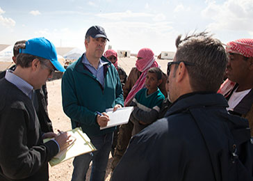 Mike Abramowitz (center), director of the Museum's Center for the Prevention of Genocide, and <i>Washington Post</i> columnist Michael Gerson (left) collect eyewitness accounts from the refugees.