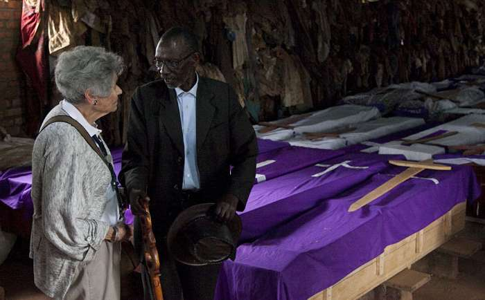 Margit Meissner, a survivor of the Holocaust, and Jean Baptiste Munyankor, a survivor of the Rwandan genocide, talk inside Ntarama Memorial Church in Rwanda, April 1, 2014.