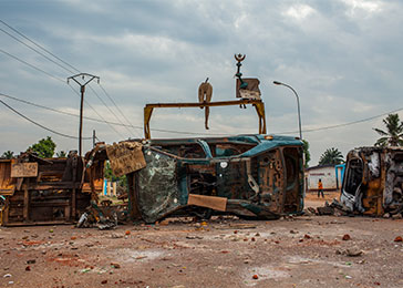 The largely Christian self-defense forces known as the Anti-Balaka set up this roadblock in Bangui, CAR's capital. Affixed to the top of it is a mannequin, along with a star and crescent from a nearby mosque. March 2014.