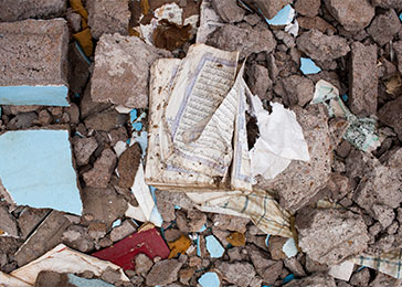 Korans and other religious texts were found at the site of a destroyed mosque in Bangui. March 2014.