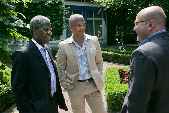 Ami Mpungwe (left), the lead facilitator of the Arusha negotiations from Tanzania; Don Webster (center), former senior appeals counsel and senior trial attorney at the International Criminal Tribunal for Rwanda (1999–2012); and Michael Barnett (right), a professor from George Washington University in Washington, DC, share a moment outside The Hague Institute for Global Justice between conference sessions.