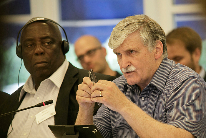 Lieutenant-General Roméo Dallaire (center), the force commander of the United Nations Assistance Mission for Rwanda (UNAMIR), recounts his experience as a peacekeeper and what it was like to be tasked with implementing the 1993 Arusha Peace Accords, as his former deputy, Major-General Henry Anyidoho (far left), looks on.