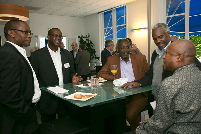 (From left) Venuste Nshimiyimana, a former UNAMIR information officer and BBC Africa correspondent; Senator Jean-Damascène Bizimana of Rwanda; Faustin Kagamé, communications advisor to Rwandan President Paul Kagame; Charles Murigande, the Washington representative for the Rwandan Patriotic Front (RPF) (1990–94), and Patrick Mazimhaka, former vice-chairman of the RPF (1993–98) chat over lunch just outside The Hague Institute for Global Justice.