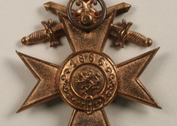Military Merit Cross 3rd Class with Swords awarded to German-Jewish soldier Maier Firnbacher in 1916 for bravery while serving in the German army during World War I. Maier and his family later left Germany to escape increasing persecution.