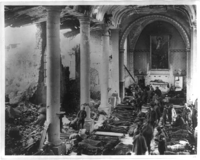 An American army field hospital inside the ruins of a church. France, 1918.