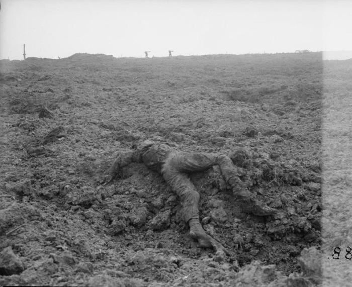A fallen soldier lies in the mud. Third Battle of Ypres. Belgium, 1917.